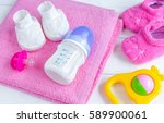 baby bottle with milk and towel ... | Shutterstock . vector #589900061