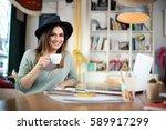young happy businesswoman... | Shutterstock . vector #589917299