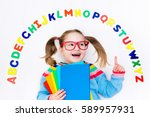 happy preschool child learning... | Shutterstock . vector #589957931