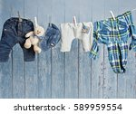 Stock photo baby clothes hanging on the clothesline 589959554