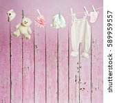 Stock photo baby clothes hanging on the clothesline 589959557