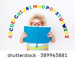 happy preschool child learning... | Shutterstock . vector #589965881