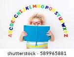 happy preschool child learning... | Shutterstock . vector #589965881