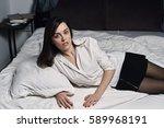 stylish elegant lady lying in... | Shutterstock . vector #589968191