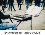 street musician giving a... | Shutterstock . vector #589969325