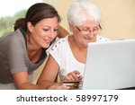 elderly woman and young woman... | Shutterstock . vector #58997179