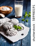 Small photo of Chocolate crinkle cookies with powdered sugar icing