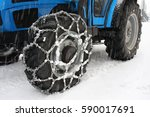 snow chains at tractor wheels | Shutterstock . vector #590017691