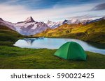 alpine valley glowing by... | Shutterstock . vector #590022425
