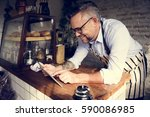 man using devices for online... | Shutterstock . vector #590086985