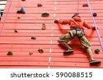 sporty man practicing rock... | Shutterstock . vector #590088515