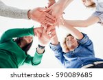 co workers hand put together in ... | Shutterstock . vector #590089685