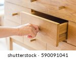 use hand pull open drawer... | Shutterstock . vector #590091041