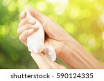 hand hold cream lotion   care... | Shutterstock . vector #590124335