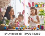 a mother and her daughter are... | Shutterstock . vector #590145389