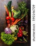 fresh vegetables in basket on... | Shutterstock . vector #590146709