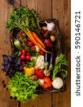 fresh vegetables in basket on... | Shutterstock . vector #590146721