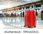 red suitcase in airport... | Shutterstock . vector #590163311