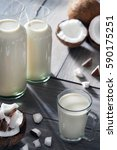 cocos milk in glass on the table | Shutterstock . vector #590175251