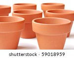 Little clay flower pots on white background.  Macro with shallow dof. - stock photo