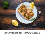 salmon roasted in an oven with... | Shutterstock . vector #590193011
