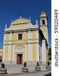 Yellow church against blue sky, Locate Di Triulzi, Milan, Lombardy, Italy - stock photo