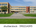 Small photo of Public school building. Exterior view of school building with playground.