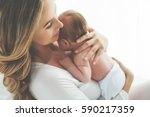 a woman with a baby  | Shutterstock . vector #590217359