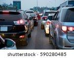 cars on urban street in traffic ...   Shutterstock . vector #590280485