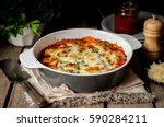 Stock photo baked stuffed conchiglioni with tomato sauce rustic style 590284211