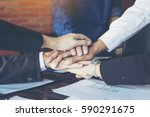 business people join hand while ... | Shutterstock . vector #590291675