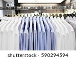 shirts hanging on rack | Shutterstock . vector #590294594