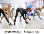 group of women working out in... | Shutterstock . vector #590308721
