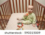 baby in crib | Shutterstock . vector #590315009