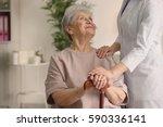 elderly woman holding hands on... | Shutterstock . vector #590336141