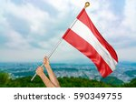 young man's hands proudly... | Shutterstock . vector #590349755