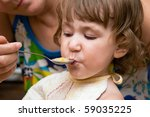 ma feeds child | Shutterstock . vector #59035225