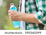 midsection of man with energy... | Shutterstock . vector #590360399