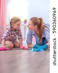 mother and daughter cleaning up ... | Shutterstock . vector #590360969