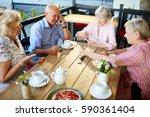 Smiling Elderly People Having...