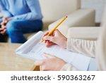 psychologist in brown cardigan... | Shutterstock . vector #590363267