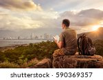 traveler with backpack sitting...   Shutterstock . vector #590369357