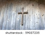 Wooden Cross On A Wooden Wall...