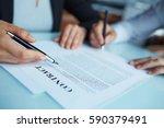 closeup shot of two business... | Shutterstock . vector #590379491