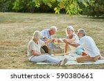 senior citizens having fun at a ... | Shutterstock . vector #590380661