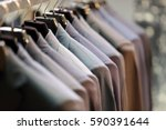 row of men's suits hanging on... | Shutterstock . vector #590391644