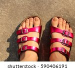Woman Feet With Purple Sandals...