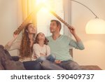 family in house planning with... | Shutterstock . vector #590409737