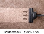 vacuuming carpet with vacuum... | Shutterstock . vector #590434721
