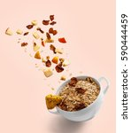 bowl of healthy oatmeal with... | Shutterstock . vector #590444459